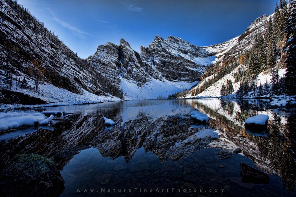 photo of mountain reflection on lake agnes tea house banff