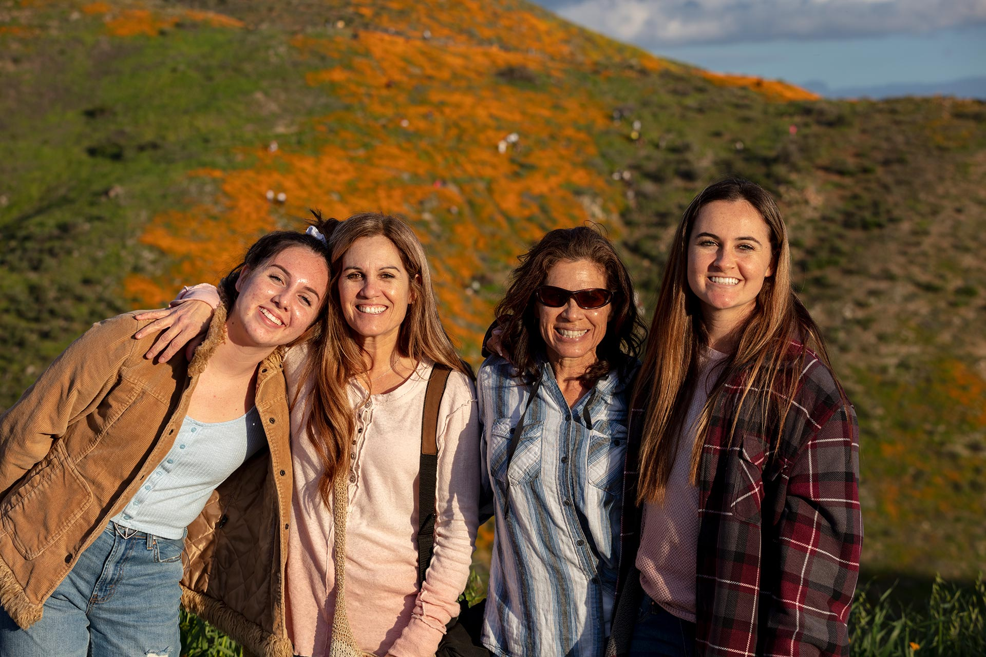 family standing at Walker Canyon poppies superbloom