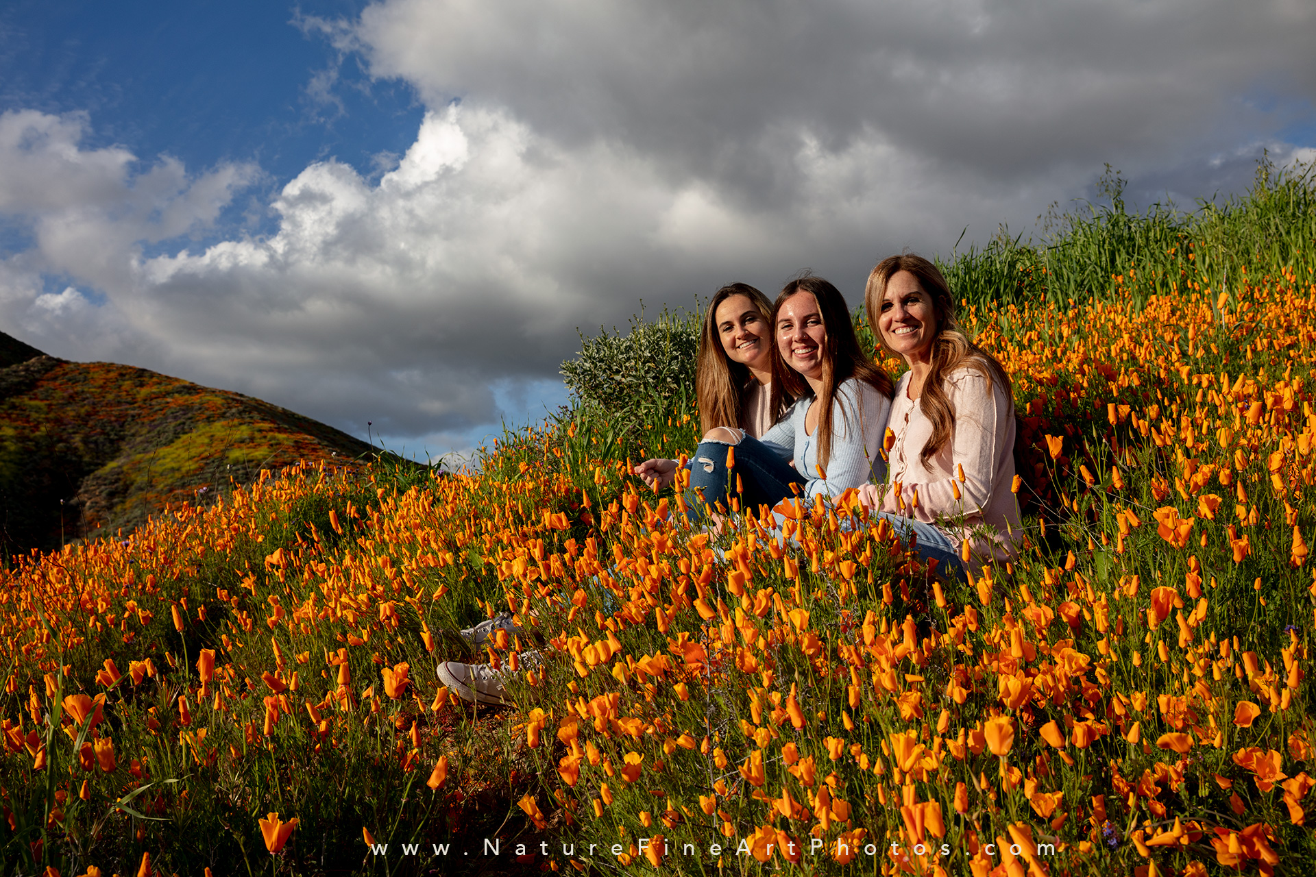 family sitting in poppies Walker Canyon