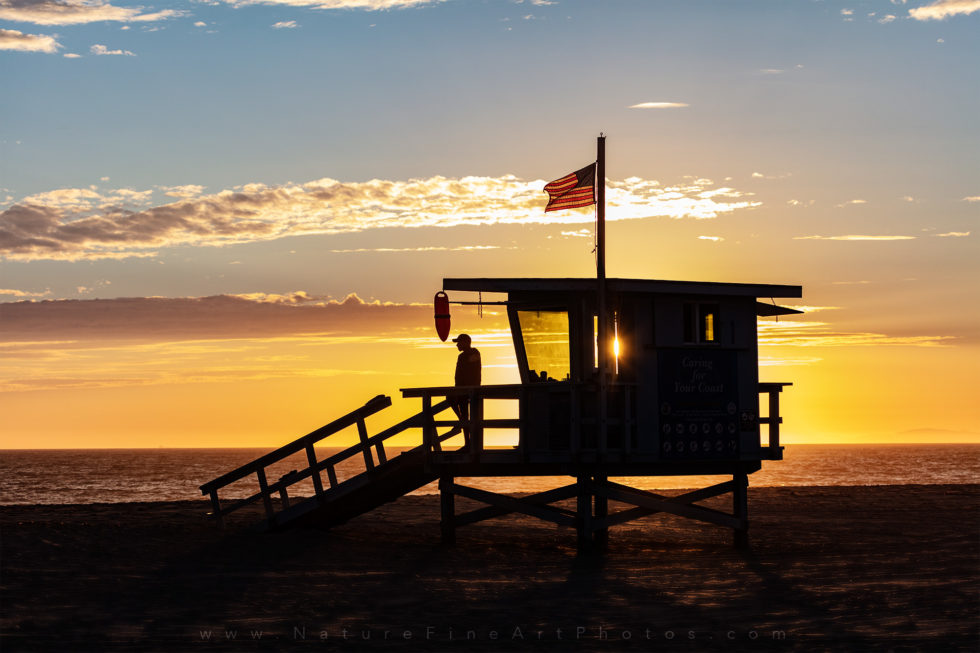photo of lifeguard tower at sunset